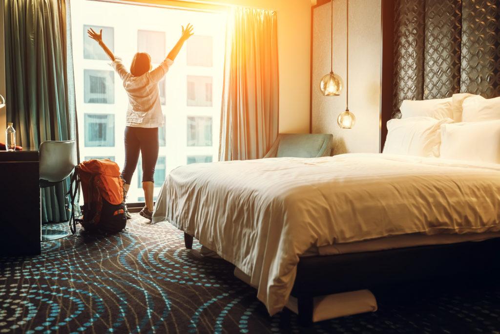 Woman in Hotel Room Window